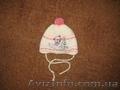Продам детскую шапочку на осень